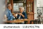 senior couple talking over a... | Shutterstock . vector #1181901796