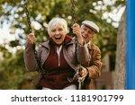 senior man pushing his female... | Shutterstock . vector #1181901799