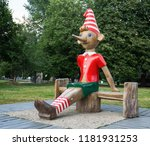 Small photo of MOSCOW, RUSSIA - June 19, 2018: Wooden sculpture of Buratino (Russian Pinocchio)in the park