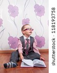 sitting little boy with diary... | Shutterstock . vector #118193758