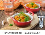 pumpkin baked in a tomato sauce with garlic and herbs - stock photo