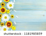Stock photo white daisies and garden flowers on a light blue worn wooden table empty space on the other side 1181985859