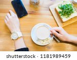 woman sitting at a table with a ... | Shutterstock . vector #1181989459