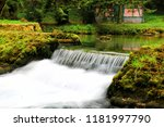 mountain stream among the mossy ... | Shutterstock . vector #1181997790
