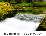 mountain stream among the mossy ... | Shutterstock . vector #1181997799