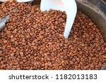 roasted coffee beans background | Shutterstock . vector #1182013183