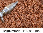 roasted coffee beans background | Shutterstock . vector #1182013186