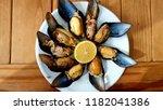 stuffed mussels on the plate  ... | Shutterstock . vector #1182041386