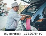 senior man with shopping bags  | Shutterstock . vector #1182075460