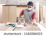 portrait of worker at carpenter ...   Shutterstock . vector #1182086023