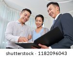 cheerful real estate agent... | Shutterstock . vector #1182096043