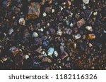 dark soil and natural stones... | Shutterstock . vector #1182116326