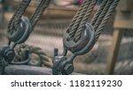 boat rope tied on hoist   Shutterstock . vector #1182119230