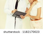 male doctor and female patient...   Shutterstock . vector #1182170023