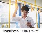 young asian man traveler... | Shutterstock . vector #1182176029