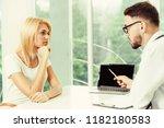 male doctor is talking to...   Shutterstock . vector #1182180583