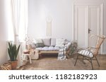 wooden sofa with cushions in... | Shutterstock . vector #1182182923