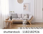 wooden table next to beige... | Shutterstock . vector #1182182926