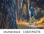 happy bearded man cyclist rides ... | Shutterstock . vector #1182196276