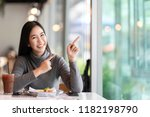 young attractive asian woman... | Shutterstock . vector #1182198790