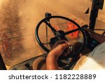 inside the harvester  farmer... | Shutterstock . vector #1182228889