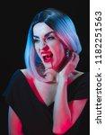 grim woman showing vampire... | Shutterstock . vector #1182251563