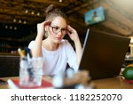 young stressed asian freelancer ... | Shutterstock . vector #1182252070