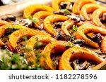 pumpkin slices baked in the... | Shutterstock . vector #1182278596
