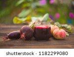 beet  juice in glass on wooden... | Shutterstock . vector #1182299080