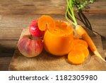 carrot juice in glass on wooden ... | Shutterstock . vector #1182305980