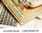 newspapers and laptop. pile of... | Shutterstock . vector #1182306970