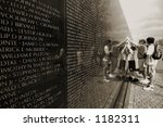 Vietnam veterans memorial (shallow DOF, people out of focus) - stock photo
