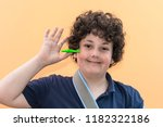boy playing with fidget spinner ... | Shutterstock . vector #1182322186