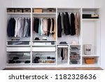 clothes hanging on rail in... | Shutterstock . vector #1182328636