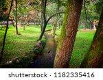 beautiful park scene  | Shutterstock . vector #1182335416