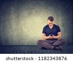 young man using mobile phone... | Shutterstock . vector #1182343876