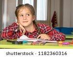 litle girl doing homework | Shutterstock . vector #1182360316