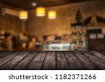 wood table on blur background... | Shutterstock . vector #1182371266