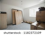 bedroom of a new home with... | Shutterstock . vector #1182372109