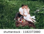 the wife and husband sittting... | Shutterstock . vector #1182372880