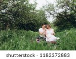 the wife and husband sittting... | Shutterstock . vector #1182372883