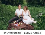 the wife and husband sittting... | Shutterstock . vector #1182372886