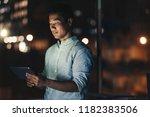 young asian businessman using a ... | Shutterstock . vector #1182383506