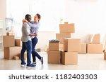 interracial couple with carton... | Shutterstock . vector #1182403303