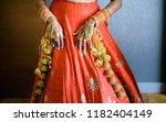 indian bridal showing wedding... | Shutterstock . vector #1182404149