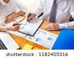 business team data analyzing... | Shutterstock . vector #1182405316