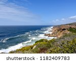 Small photo of The Indian Ocean seen from the Oyster Catcher Trail near Mosselbay on the Garden Route in South Africa with rock formations and waves in an area known for rough seas and strong currents