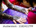 mehndi artist making mehndi... | Shutterstock . vector #1182411799