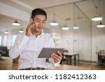 young asian businessman talking ... | Shutterstock . vector #1182412363