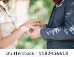 the bridegroom puts on the...   Shutterstock . vector #1182456613